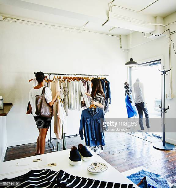 Two women shopping together in clothing boutique
