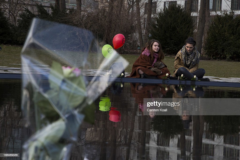 Two women sit on a pond inside the Memorial for under Nazism murdered Sinti and Roma of Europe as ethnic Roma protest against discrimination against Roma on International Roma Day on April 8, 2013 in Berlin, Germany. Western Europe has experienced a large influx of Roma, who are also called Gypsies, from Romania and Bulgaria in recent years following the accession of the two countries to the European Union. Restrictions on the rights of Romanian and Bulgarian citizens to work in the EU are scheduled to end at the end of 2013.