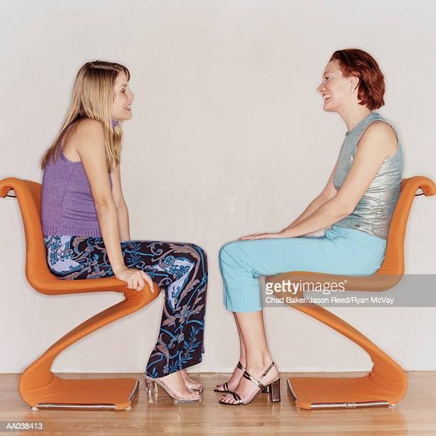 Two Women Sitting Face to Face
