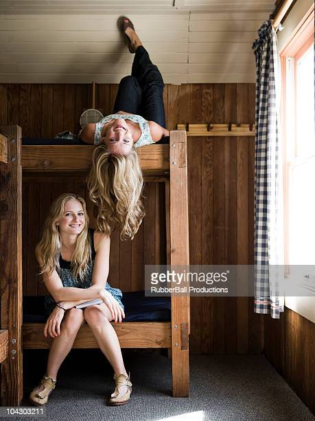 two women sitting on bunk beds