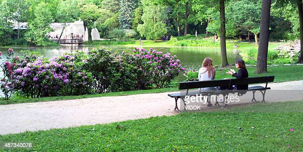 Two women sitting on park's banch.