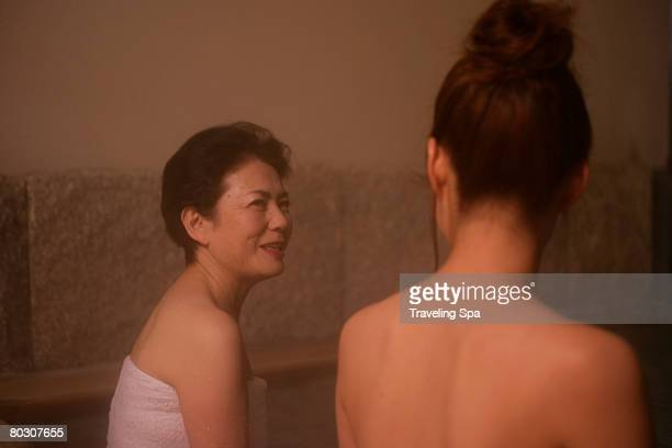 Two women soaking in hot tub