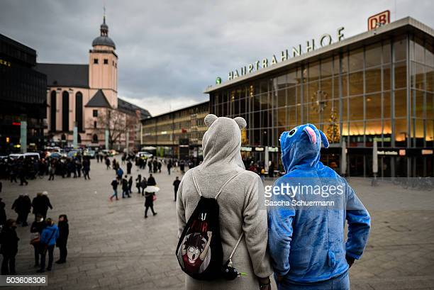 Two women stand in front of Hauptbahnhof main railway station on January 6 2015 in Cologne Germany 90 women have filed charges with police over what...