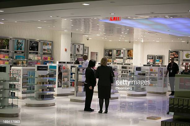 Two women stand inside of a DutyFree shop inside terminal 4 at John F Kennedy International Airport in New York US on Friday May 24 2013 Delta Air...