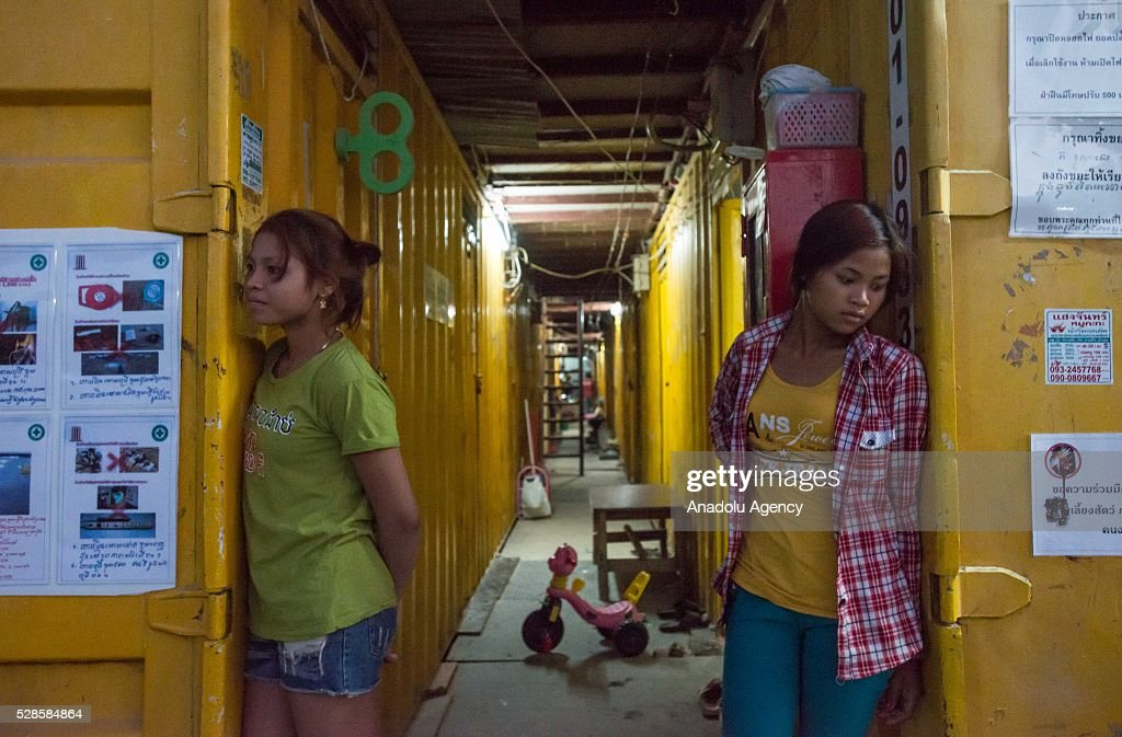 Two women stand on the corridor at a construction workers' camp on May 6, 2016 in Bangkok, Thailand. Mainly migrants from neighboring countries, like Cambodia and Laos, live in this camp, which has grocery shops, a common washing area and even a small school, on the outskirts of Bangkok.