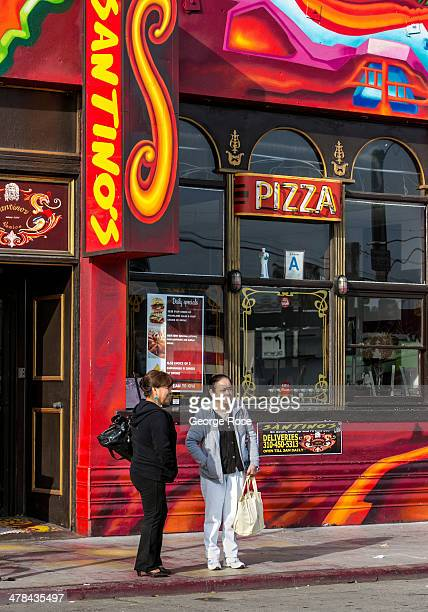 Two women stand outside a colorul pizza restaurant on March 3 in Venice Beach California Millions of tourists flock to the Los Angeles area to visit...