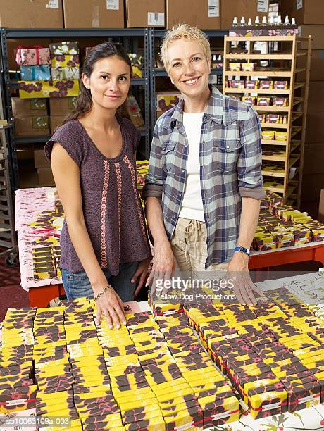 Two women standing in shop, smiling
