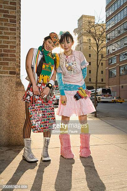 Two women standing on sidewalk, portrait