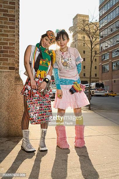 Two women standing on sidewalk, portrait