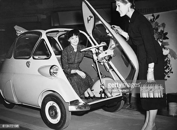 Two women take a look at the new BMW Isetta bubble car at the Earls Court Motor Show in 1955