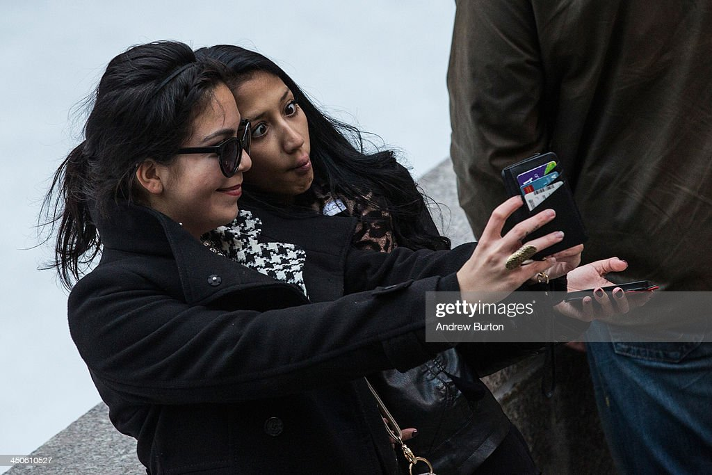 Two women take a 'selfie' outside Rockefeller Center on November 19, 2013 in New York City. Oxford Dictionary named 'Selfie' the new word of the year. The word is defined as 'a photograph that one has taken of oneself, typically with a smartphone or webcam and uploaded to a social media website.' The terms 'binge-watch' and 'twerk' were shortlisted.