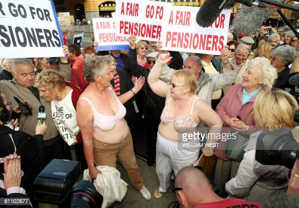 Two women take off their tops as hundreds of pensioners disrupted traffic in Melbourne's city centre in a protest against the Rudd government's lack...