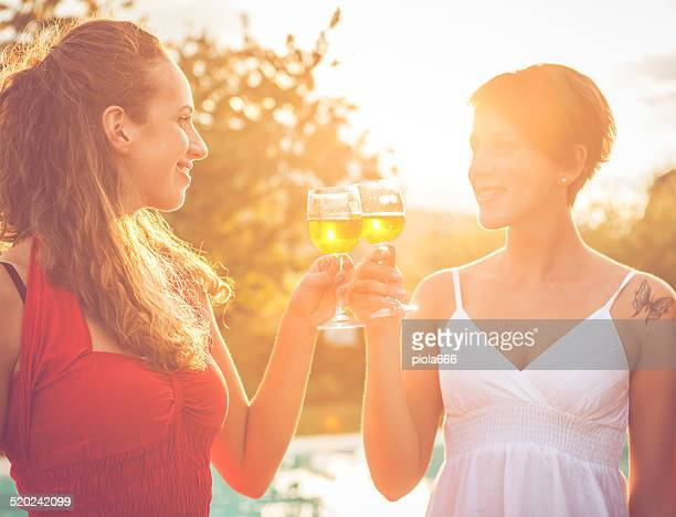 Two women toasting with wine in cheerful moment