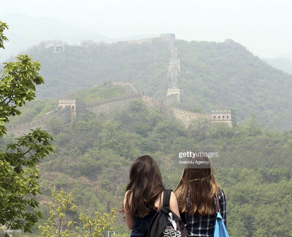 Two women tourists look at the view of the Great Wall of China in Beijing, China on April 30, 2016.