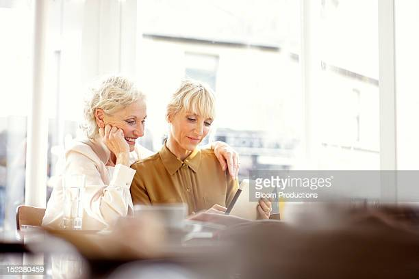 two women using technology