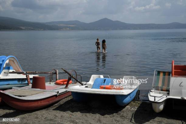 Two women wade into Lake Bracciano 32 km northwest of Rome as the Mayor of Rome decided whether or not to ration drinking water due to a drought on...