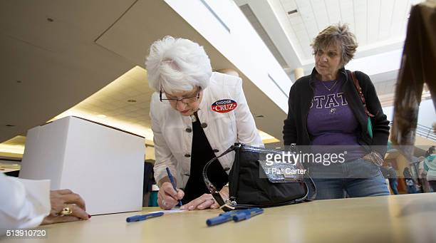 Two women wait in line to cast their ballots during the state's Republican caucus on March 5 2016 in Wichita Kansas People were standing in line for...