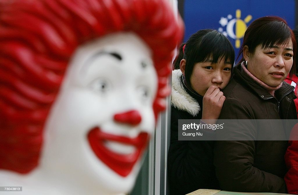 Two women wait to enter at a new McDonald's drive-thru facility on January 19, 2007 in Beijing, China. McDonald's opened its first restaurant in mainland China in 1990, in Shenzhen, Guangdong province and now operates 760 restaurants countrywide, which employ over 50,000 people.