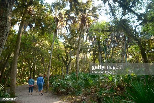 Two women walk along a path at Myakka State Park in Sarasota Florida