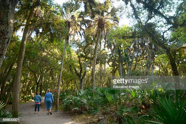 Two women walk along a path at Myakka State Park in Sarasota Florida