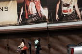 Two women walk by a closed storefront on April 17 2009 in Newark New Jersey Newark New Jersey's largest city is struggling to hold onto economic...