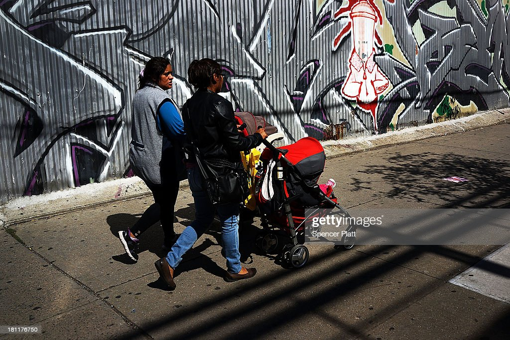 Two women walk down a street in the South Bronx on September 19, 2013 in New York City. According to the 2010 U.S. Census Bureau report, over a quarter-million people in the South Bronx are living in poverty, making the 16th Congressional District the poorest in the nation. New Census Bureau numbers for all of New York City show that the poverty rate has risen to 21.2 percent in 2012, from 20.9 percent the year before. As New Yorkers prepare to vote for their next mayor following Michael Bloomberg, the Democratic candidate Bill de Blasio has focused on the theme that New York has transformed into a 'tale of two cities' under the Bloomberg administration.