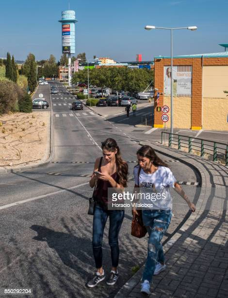 Two women walk out of Sintra Retail Park one of four commercial centers owned by The Blackstone Group in Lisbon region on September 20 2017 in Sintra...