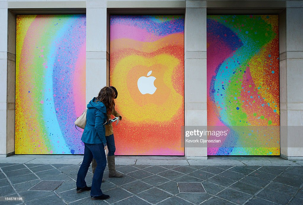 Two women walk past Apple signage at the historic California Theater on October 22, 2012 in San Jose, California. Apple is set to introduce its long-rumored iPad Mini during a news conference on Tuesday.