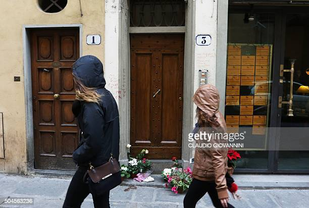 Two women walk past the entrance to the building that houses the flat of Ashley Olsen a 35yearold American expatriate artist who was found dead on...