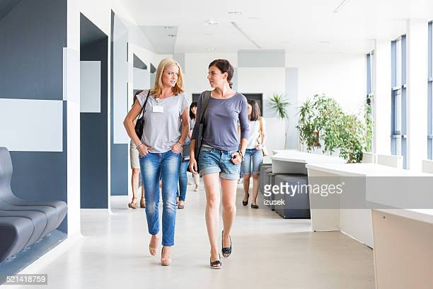 Two women walking down the hall