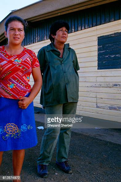 Two women watch a graduation ceremony for Sandinista soldiers in military training Rising to power within the Nicaraguan government in the 1980s the...