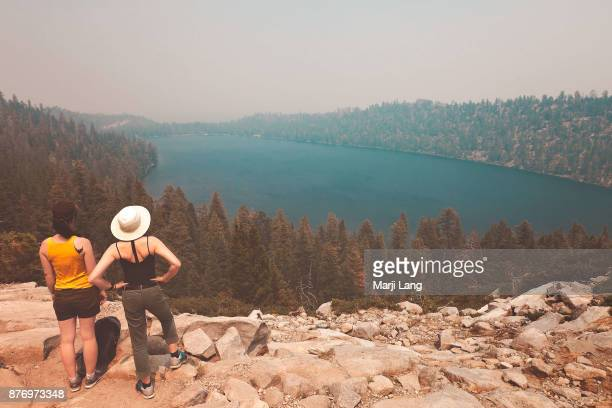 Two women watching over Emerald bay at Lake Tahoe California USA