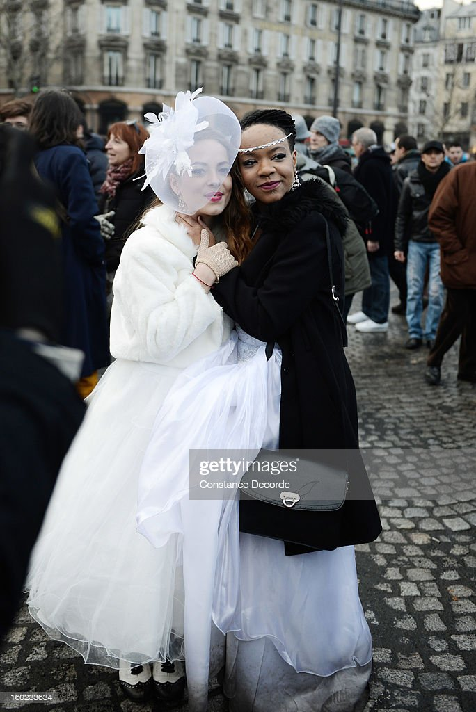 Two women wear a wedding dresses during the marriage for all demonstration on January 28, 2013 in Paris, France. The marriage equality bill, which will be debated at the French National Parliament, would not only legalize same-sex marriage and also allow gay couples to adopt, a controversial issue in the bill. French President Francois Hollande supports the legislation but faces criticism from anti-gay and religious groups, while gay rights groups have concerns of inadequacies within the bill.