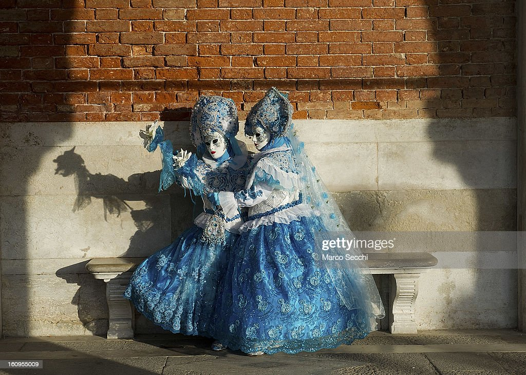 Two women wearing a carnival costume pose in Saint Mark's Square on February 8, 2013 in Venice, Italy. The 2013 Carnival of Venice runs from January 26 - February 12 and includes a program of gala dinners, parades, dances, masked balls and music events.