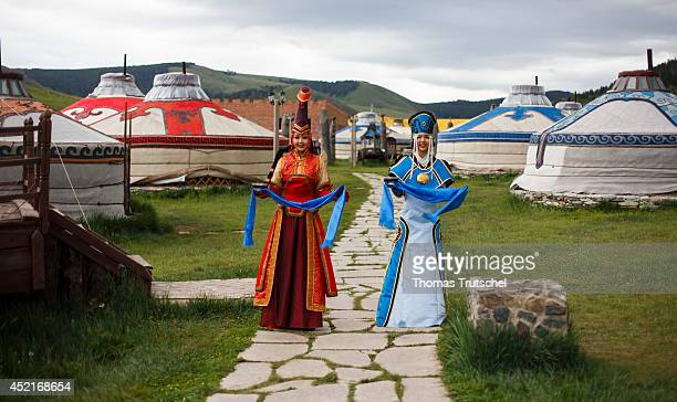 Two women wearing costumes waiting at the entrance of the Chinggis Khaan Khuree Ger camp close to Ulan Bator to welcome the German Foreign Minister...