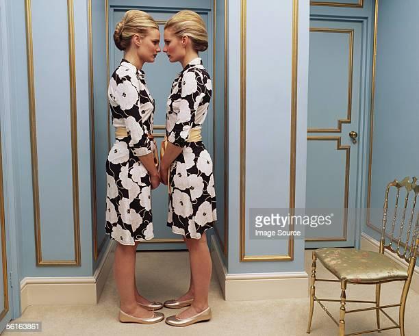 Two women wearing the same dress