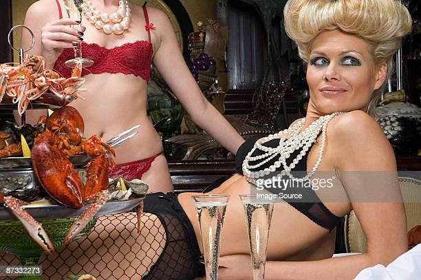 Two women wearing underwear in a banquet hall