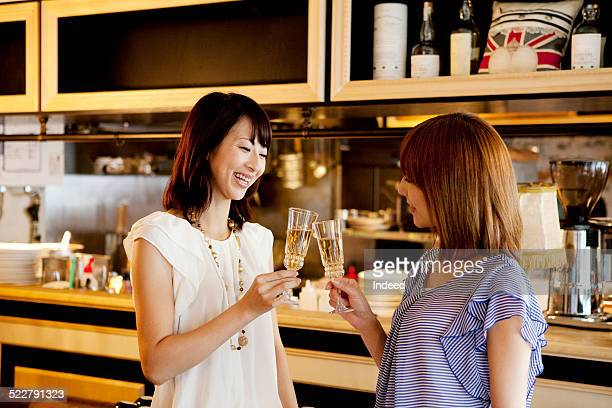 Two women who drink a toast