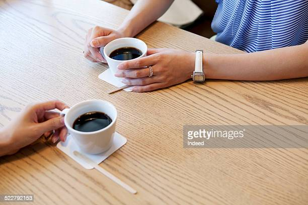 Two women who sit in a coffee shop