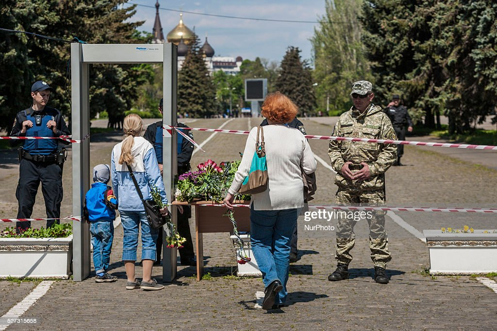Two women with flowers are stopped by policemen at the entrance to Kulikovo Pole square in Odessa, southern Ukraine, on May 2, 2016, in remembrance of the dead people in the Trade Unions House clashes on 2nd of May on 2014. The square was closed because a bomb threat.
