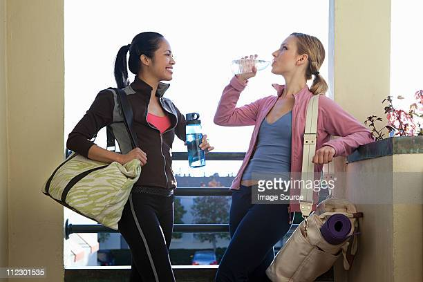 Two women with gym bags