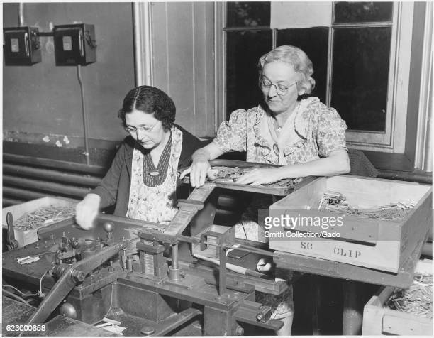 Two women working on the clip spring and bolt assembly for the 3 caliber cartridges at the Frankford Arsenal in Philadelphia Pennsylvania 1940 Image...