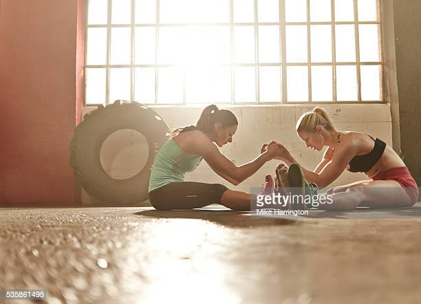 Two women working out together in gym