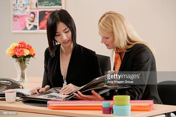 Two women working together
