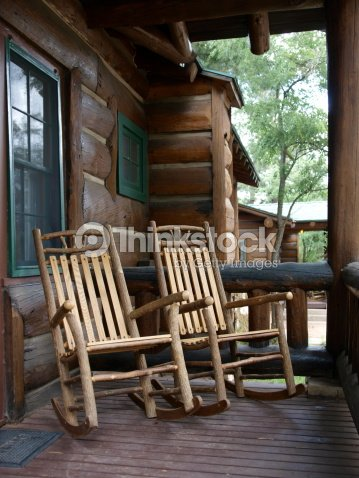 two wood rocking chairs on log cabin porch stock photo thinkstock. Black Bedroom Furniture Sets. Home Design Ideas