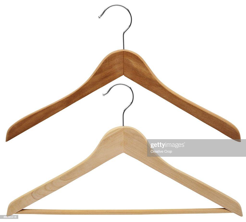 Two wooden coat hangers : Stock Photo
