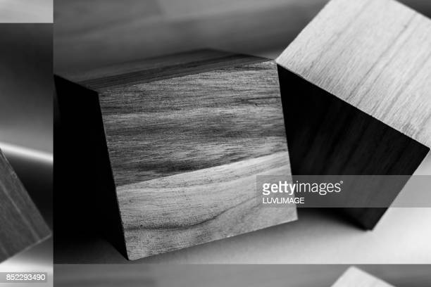 Two wooden cubic shapes.