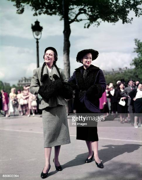 Two wool models by Nina Ricci of Paris Left is 'Rosa Bonheur' a black and white check suit trimmed with astrakhan and right 'La Valliere' a violet...