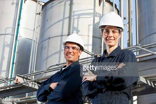 Two workers at industrial plant