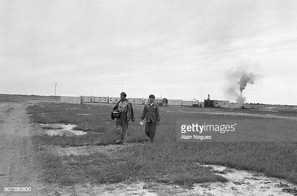 Two workers from the 1202 model unit walk over the Manchurian Steppe towards their lodgings